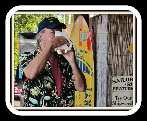 Bob sounding conch shell at Pine Island Reader Rendezvous