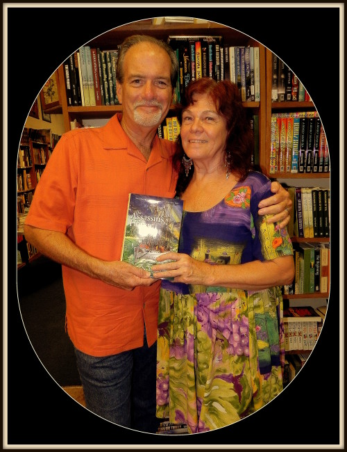 Author Macomber with Janet Bollum, owner of The Muse Bookshop in DeLand, Florida holding the newest novel, The Assassin's Honor