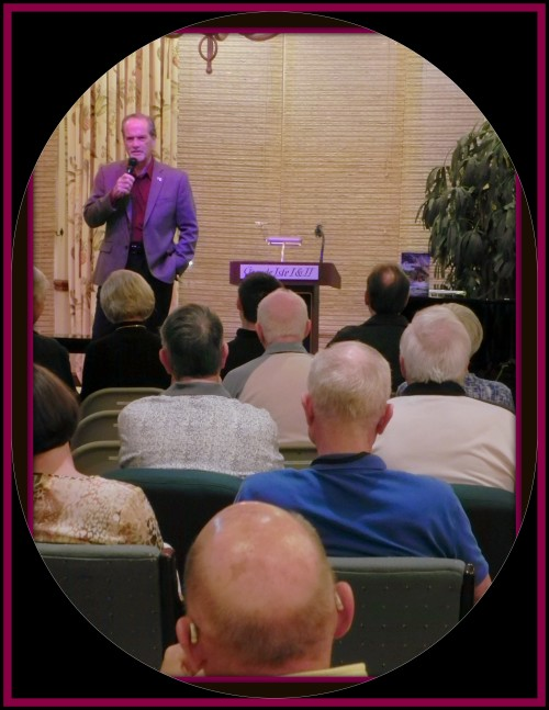 Author and historian Robert N. Macomber speaks to a full house at the Grande Isles Towers in Burnt Store Marina about his 12th novel in the Honor Series called The Assassin's Honor.