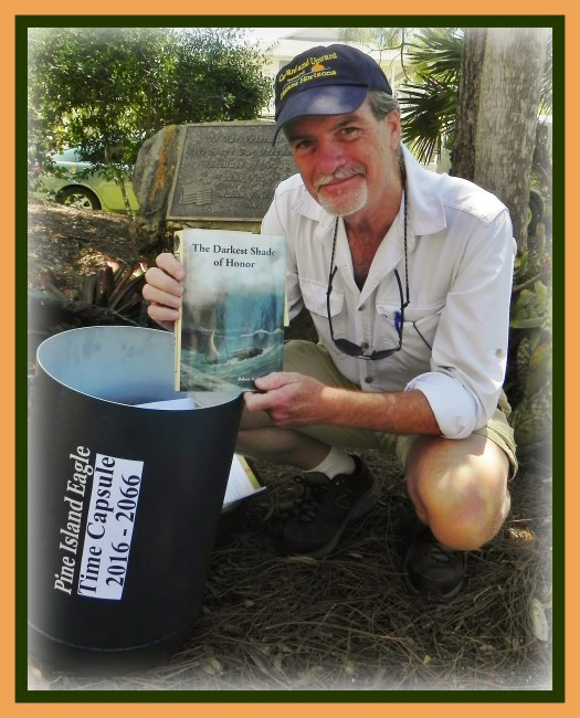 Author and historian, Robert N. Macomber places his novel, The Darkest Shade of Honor into the Pine Island, Florida Time Capsule to be opened again in April of 2066, fifty years from now, and is being kept at The Museum of The Islands.