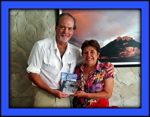 Robert Macomber meeting with Dr. Olga Portunado Zuniga, the Director of the Office of History for Santiago de Cuba in eastern Cuba researching for his Honor Series novels.