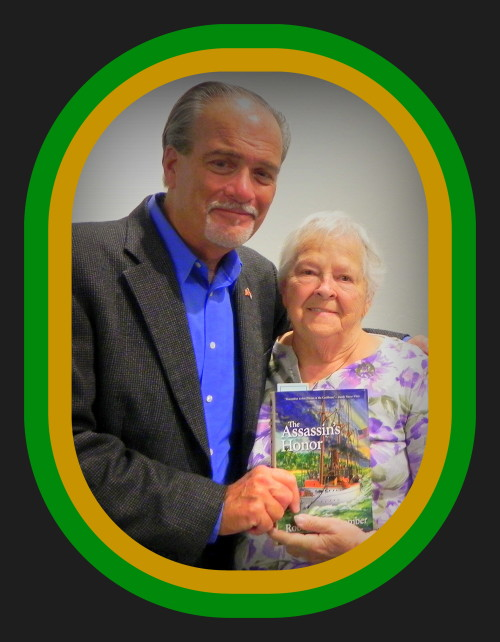 Old friend, Ann Alsop is holding her newly signed novel, The Assassin's Honor with author Robert N. Macomber at the Estero Island Historical Society event.