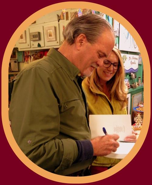 Author Robert N. Macomber signs one of many books bought at the Pine Bay Gallery Holiday Party in Matlacha, FL.