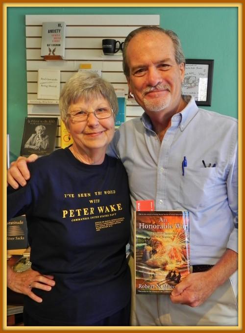 Wakian, Barbara Stokes [aka: one of the Wicked Sistas] at MacIntosh Books buying Robert N. Macomber's latest novel in the Honor Series, An Honorable War on Sanibel Island, FL.