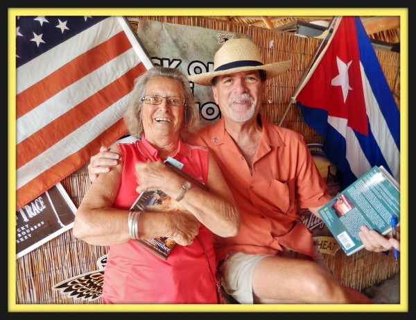 Judi Sellers poses with author Robert N. Macomber after getting one of her copies of An Honorable War signed, and she is also one of the travelers from Macomber's Inaugural Havana Reader Rendezvous.