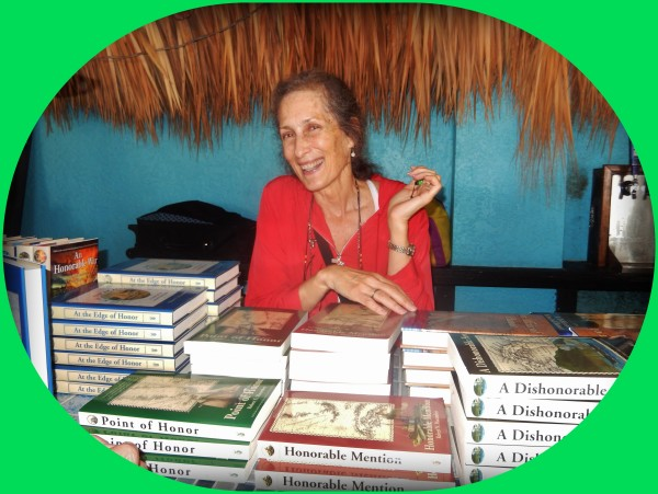 Books for sale! But not just any books, these are the Honor Series novels by author & historian Robert N. Macomber [pictured is Nancy Glickman, happy to help].