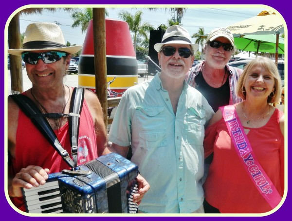 Barbara Stepien (right) celebrates her birthday & Havana Reader Rendezvous Reunion at the 14th Annual Pine Island Reader Rendezvous with the band, The Yard Dogs in honor of Robert N. Macomber's newest novel, An Honorable War.