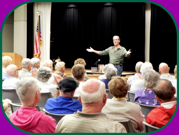 """Author and lecturer, Robert N. Macomber takes questions from a large, spellbound audience at Lakes Regional Library in Ft. Myers, FL as a part of his talk on """"An Honorable War, The Insider's Story."""""""