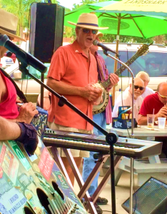 Kicking off the 14th Annual Pine Island Reader Rendezvous with the traditional sounding the conch on stage with The Yard Dogs band at Woody's Waterside Pub in St. James City, FL.