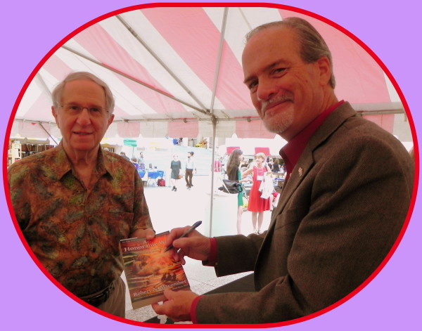 Robert N. Macomber is proud to sign his novel, An Honorable War, for a former Queen Mary II shipmate, friend and Wakian, Harry Nichol at the Southern Festival of Books in Nashville, TN.