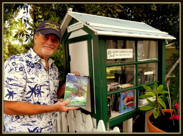 Author Robert N. Macomber donates his novel, The Assassin's Honor to the neighborhood library Charter # 35670 in West Palm Beach, Florida.
